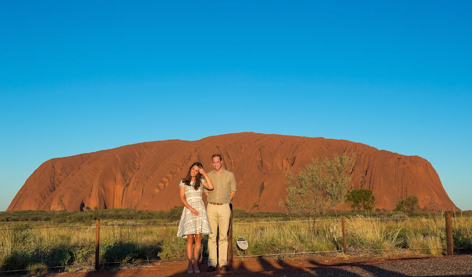 Prince William, Duke of Cambridge and Catherine, Duchess of Cambridge view Ayers Rock at sunset on April 22, 2014 in Ayers Rock, Australia. The Duke and Duchess of Cambridge are on a three-week tour of Australia and New Zealand, the first official trip overseas with their son, Prince George of Cambridge.