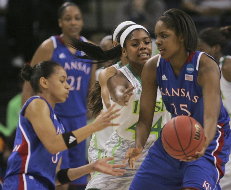 Kansas forward Chelsea Gardner (15) passes the ball to Kansas guard Angel Goodrich, left, as Notre Dame forward Ariel Braker (44) pressures during the first half a regional semi-final of the NCAA college basketball tournament Sunday, March31, 2013, in Norfolk, Va.  (AP Photo/Jason Hirschfeld)