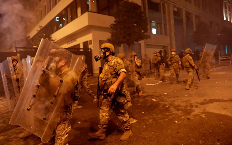 Lebanon's army could use wide powers under a proposed emergency law to crush anti-government protests, activists fear - AFP