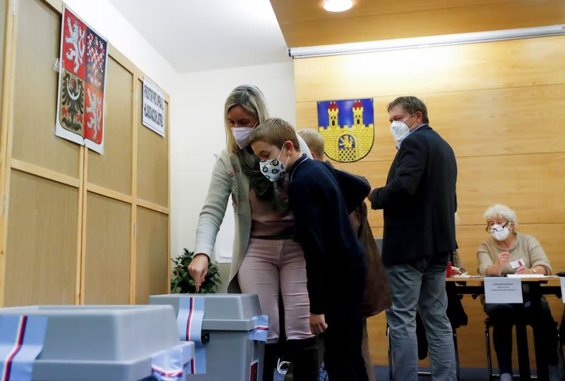 People cast their ballots during the parliamentary elections in Lovosice