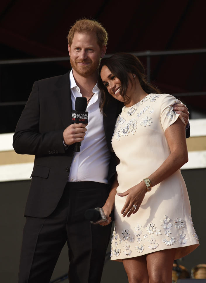 Prince Harry, the Duke of Sussex, left, and Meghan, the Duchess of Sussex speak at Global Citizen Live in Central Park on Saturday, Sept. 25, 2021, in New York. (Photo by Evan Agostini/Invision/AP)