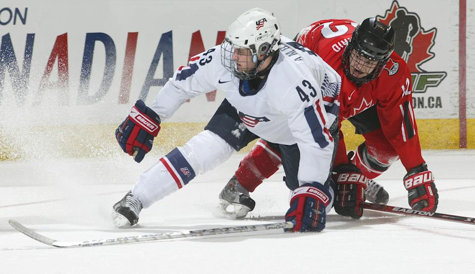 Team USA's Tyler Amburgey (No. 43) collided with Peter Holland of Team Ontario at the 2008 World Under 17 Challenge in Canada. (Photo: Claus Andersen via Getty Images)