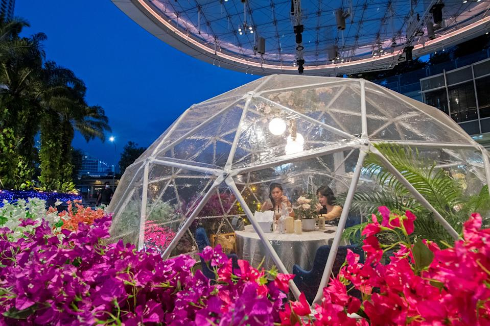 SINGAPORE, Oct. 22, 2020 -- People dine inside a dome, an installation which helps prevent the spread of the COVID-19 epidemic, at Capitol Singapore Outdoor Plaza, Singapore, on Oct. 21, 2020. (Photo by Then Chih Wey/Xinhua via Getty) (Xinhua/Then Chih Wey via Getty Images)