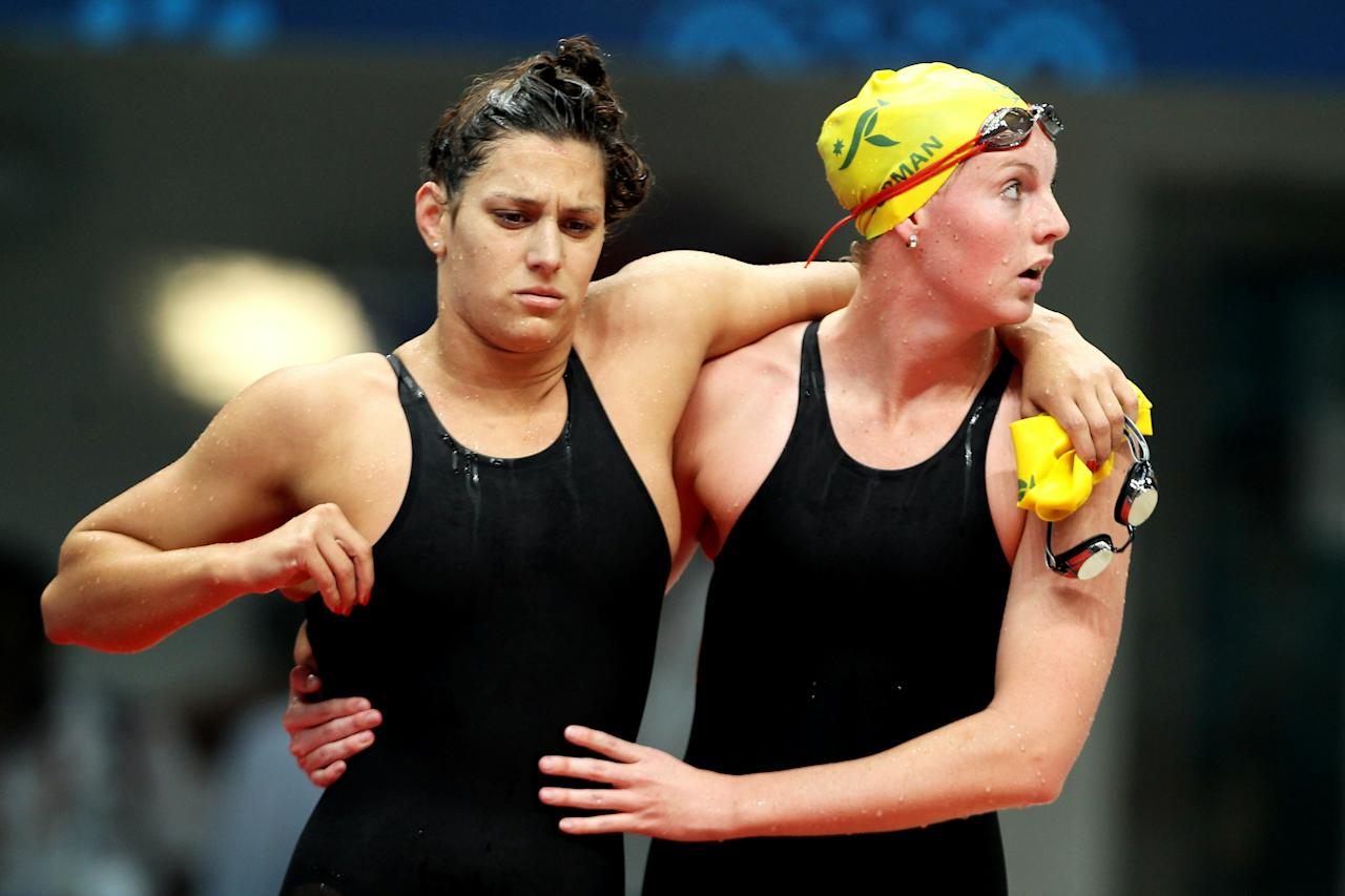 DELHI, INDIA - OCTOBER 07:  Blair Evans of Australia is consoled by Melissa Gorman of Australia after competing in the Women's 800m Freestyle Final at the Dr. S.P. Mukherjee Aquatics Complex during day four of the Delhi 2010 Commonwealth Games on October 7, 2010 in Delhi, India.  (Photo by Ian Walton/Getty Images)