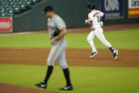 Houston Astros' Alex Bregman (2) runs the bases after hitting a home run off San Francisco Giants starting pitcher Tyler Anderson during the third inning of a baseball game Tuesday, Aug. 11, 2020, in Houston. (AP Photo/David J. Phillip)