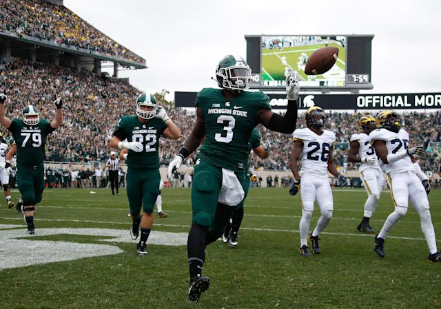 """Michigan State running back L.J. Scott got the trash talking between the Spartans and the <a class=""""link rapid-noclick-resp"""" href=""""/ncaaw/teams/max"""" data-ylk=""""slk:Michigan Wolverines"""">Michigan Wolverines</a> started elarly this season, calling the Wolverines their """"little sister"""" at the Big Ten media days in Chicago this week. (Getty Images)"""