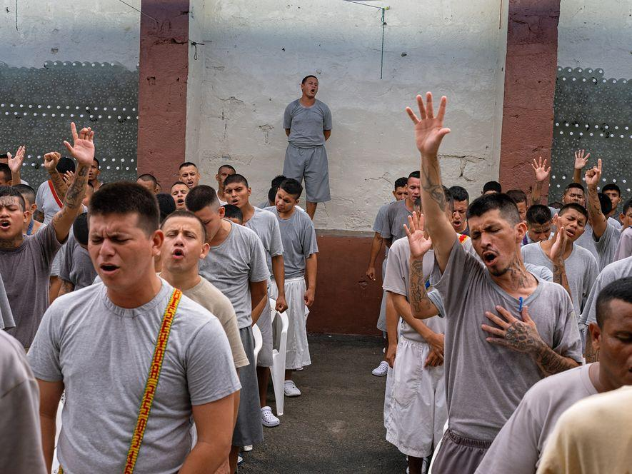 Others at Gotera who have renounced their gang ties pray together. Prison-based evangelical churches in El Salvador are growing. (National Geographic/Karine Aigner)