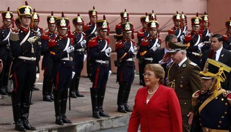 Chile's President Bachelet walks past honour guards as she arrives at the Casa Rosada Presidential Palace in Buenos Aires