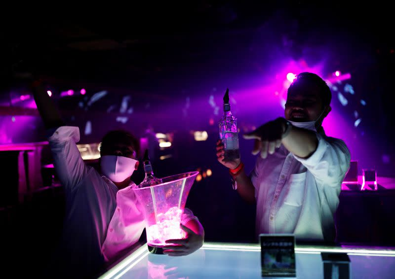 Junichi Hamana and Arjay Arai attend an LGBT event held at a club at Shibuya, following the COVID-19 outbreak, in Tokyo