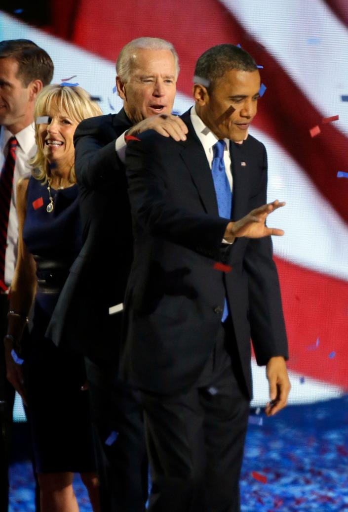 Vice President Joe Biden and President Barack Obama wave to their supporters at his election night party Wednesday, Nov. 7, 2012, in Chicago. President Obama defeated Republican challenger former Massachusetts Gov. Mitt Romney. (AP Photo/Pablo Martinez Monsivais)