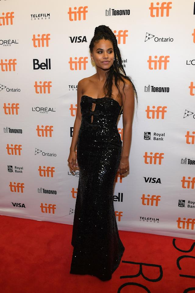 Zazie attended the <em>Lucy In The Sky</em> premiere during the 2019 Toronto International Film Festival wearing a black sequin dress with three bows down the chest. We love how she kept her jewelry and makeup simple so the focus was on the dress.