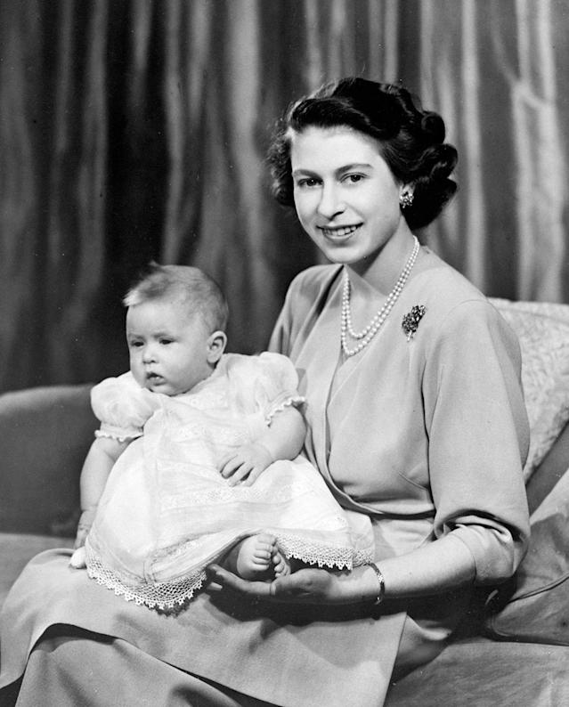 The Queen, while still Princess Elizabeth, with a baby Prince Charles in Buckingham Palace. (Getty Images)