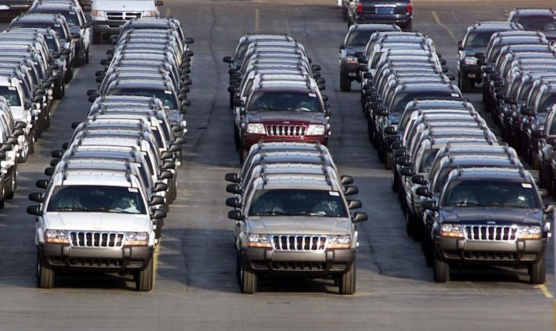 FILE - In this file photo taken Fed. 2, 2001, rows of 2001 Jeep Grand Cherokees are lined up outside the Jefferson North Assembly Plant in Detroit. The National Highway Traffic Safety Administration says on its website Thursday June 14, 2012 that it has added Jeep Liberty and Cherokee SUVs to the investigation. The probe now covers 5.1 million vehicles. The agency says 15 people have died in 26 Grand Cherokee fires. The investigation affects 1993 to 2004 Grand Cherokees. Also covered are 1993-2001 Cherokees and 2002-2007 Liberty's. (AP Photo/Carlos Osorio, File)