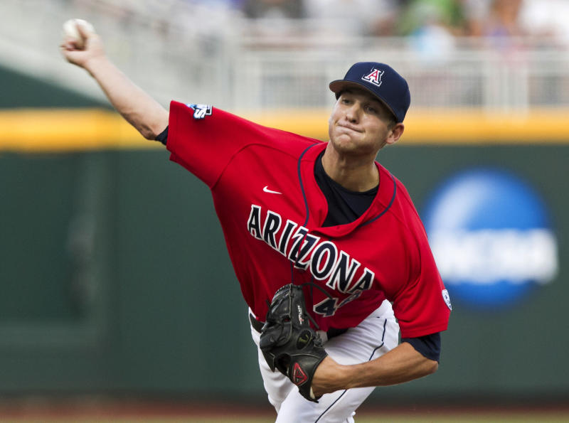 Arizona starting pitcher Konner Wade delivers against UCLA in the first inning of an NCAA College World Series baseball game in Omaha, Neb., Sunday, June 17, 2012. (AP Photo/Nati Harnik)