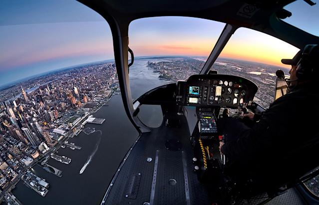 <p>The series required Andrew and his crew to fly over key locations around the city and have Andrew lean out as far as possible to photograph the city life below. (Photo: Andrew Griffiths/Lensaloft/Caters) </p>