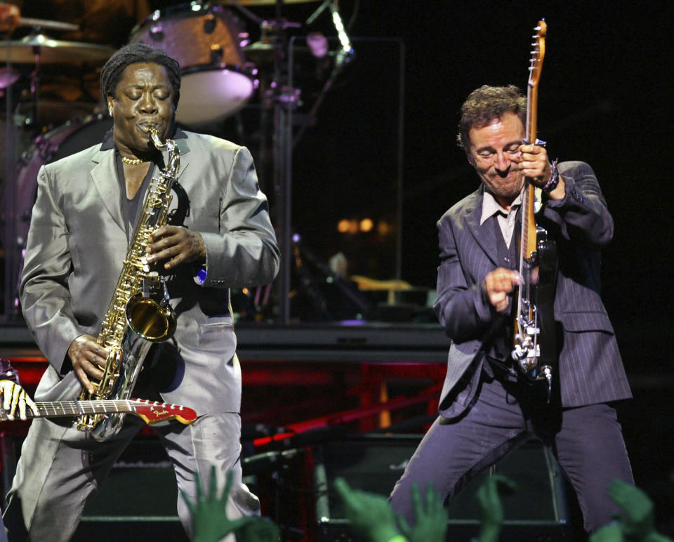 "FILE - Bruce Springsteen, right, performs with E Street Band sax player Clarence Clemons during their show in Boston on Oct. 4, 2002. Springsteen's latest album, ""Letter To You"" will be released on Oct. 23. (AP Photo/Winslow Townson, File)"
