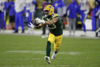 Green Bay Packers' Allen Lazard catches a pass to score on a 58-yard touchdown play during the second half of an NFL divisional playoff football game against the Los Angeles Rams Saturday, Jan. 16, 2021, in Green Bay, Wis. (AP Photo/Matt Ludtke)