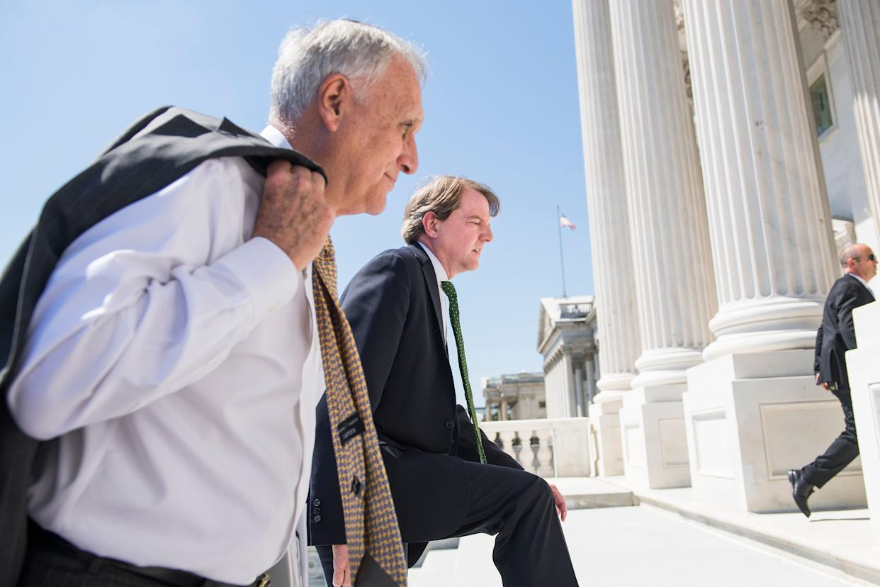 Former Sen. Jon Kyl (R-Ariz.), left, seen on July 10 as he escorts Supreme Court nominee Brett Kavanaugh and Vice President Mike Pence to meetings with senators. (Photo: Tom Williams via Getty Images)