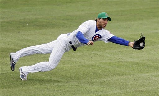 Chicago Cubs center fielder Joe Mather makes a diving catch on a ball hit by Texas Rangers' Luis Martinez in the eighth inning of a spring training baseball game, Saturday, March 17, 2012, in Las Vegas. The Rangers won 12-7. (AP Photo/Julie Jacobson)