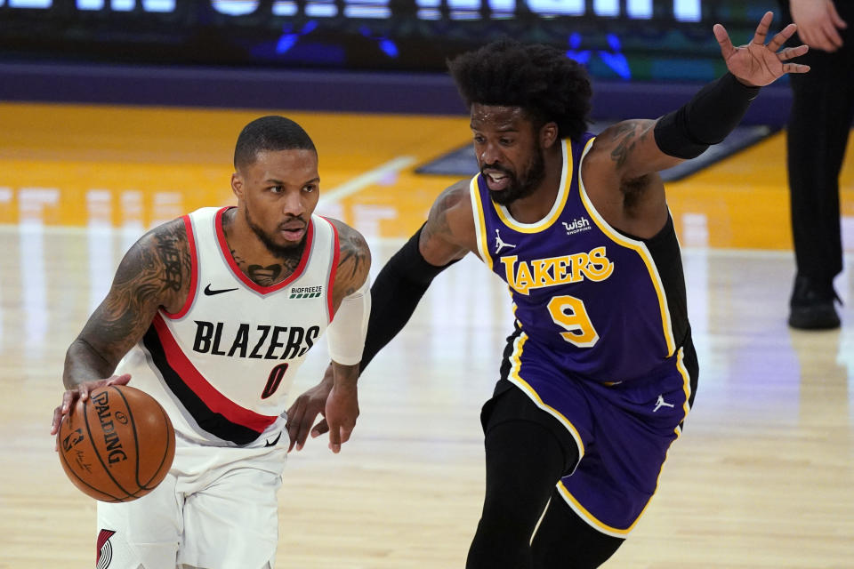Los Angeles Lakers guard Wesley Matthews (9) defends against Portland Trail Blazers guard Damian Lillard (0) during the first half of an NBA basketball game Friday, Feb. 26, 2021, in Los Angeles. (AP Photo/Mark J. Terrill)