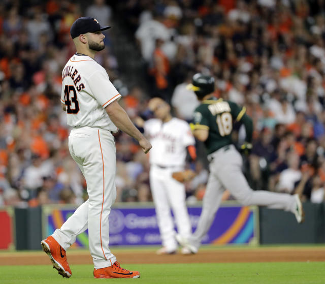 Houston Astros starting pitcher Lance McCullers Jr. (43) looks toward the outfield after giving up a three-run home run to Oakland Athletics' Chad Pinder (18) during the fourth inning of a baseball game Wednesday, July 11, 2018, in Houston. (AP Photo/David J. Phillip)