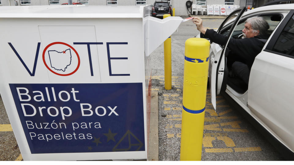 A voter drops of his election ballot in the drop box at the Cuyahoga County Board of Elections, on April 22, 2020, in Cleveland, Ohio. (Tony Dejak/AP)