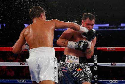 NEW YORK, NY - JULY 26: Gennady Golovkin lands the knockout punch on Daniel Geale. (Photo by Mike Stobe/Getty Images)