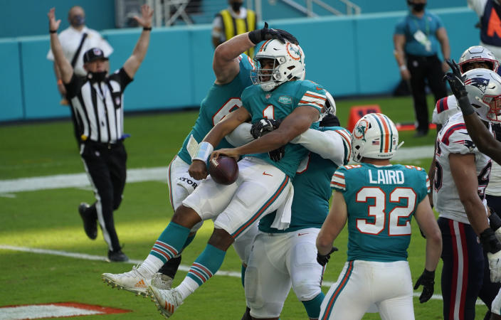 Miami Dolphins quarterback Tua Tagovailoa (1) celebrates his score against the New England Patriots during the second half of an NFL football game Sunday, Dec. 20, 2020, in Tampa, Fla. (AP Photo/Chris O'Meara)