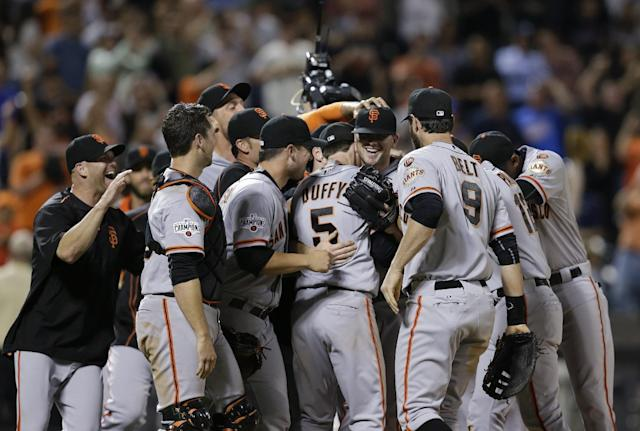 San Francisco Giants starting pitcher Chris Heston, center, celebrates with teammates after he threw a no-hitter against the New York Mets in a baseball game Tuesday, June 9, 2015, in New York. The Giants won 5-0. (AP Photo/Frank Franklin II)
