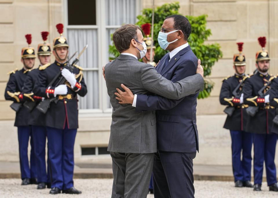 France's President Emmanuel Macron, left, welcomes Niger's President Mohamed Bazoum for a video-summit with leaders of the G5 Sahel at the Elysee Palace, Friday, July 9, 2021. (AP Photo/Michel Euler)