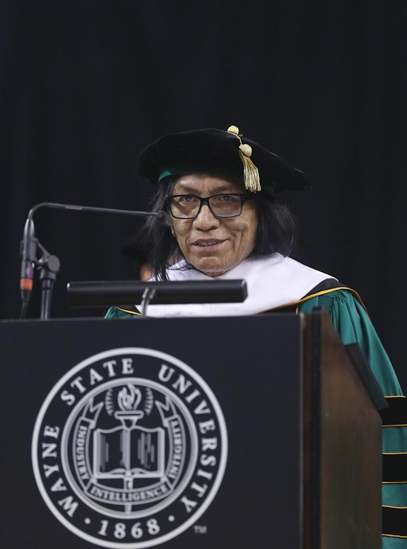 """Musician Sixto Rodriguez addresses the Wayne State University commencement ceremony after receiving a Doctor of Humane Letters honorary degree, Thursday, May 9, 2013 in Detroit, during the university's commencement ceremony. Rodriguez's two albums in the early 1970s received little attention in the United States but he unknowingly developed a cult following in South Africa during the apartheid era. He was the subject of an Oscar-winning documentary, """"Searching for Sugar Man."""".(AP Photo/Carlos Osorio)"""