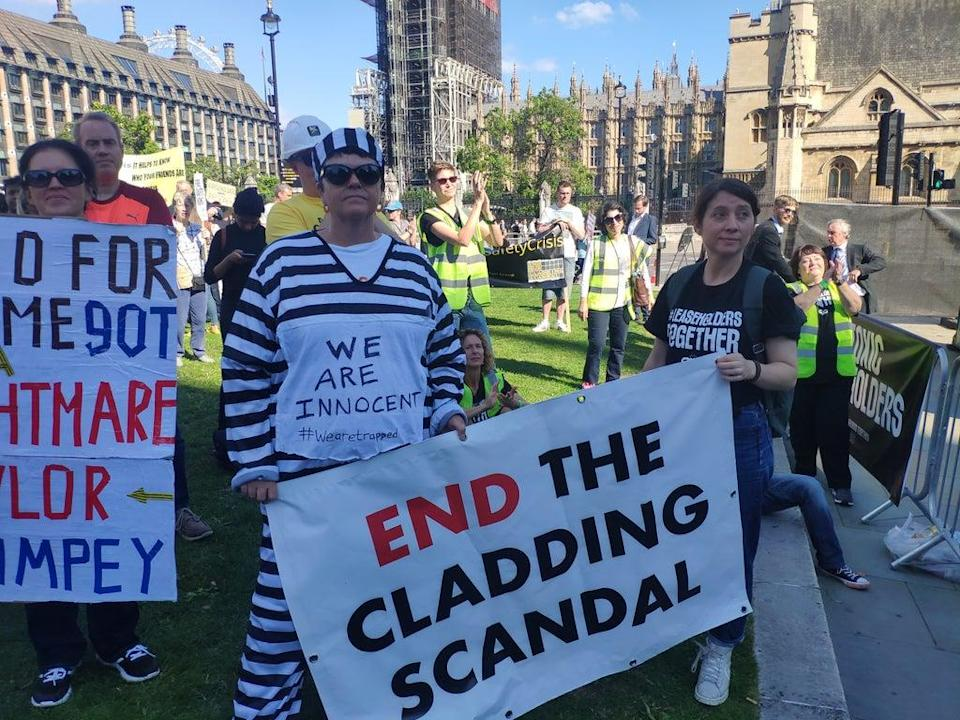 Demonstrators called for an end to the cladding crisis outside Parliament  (.)