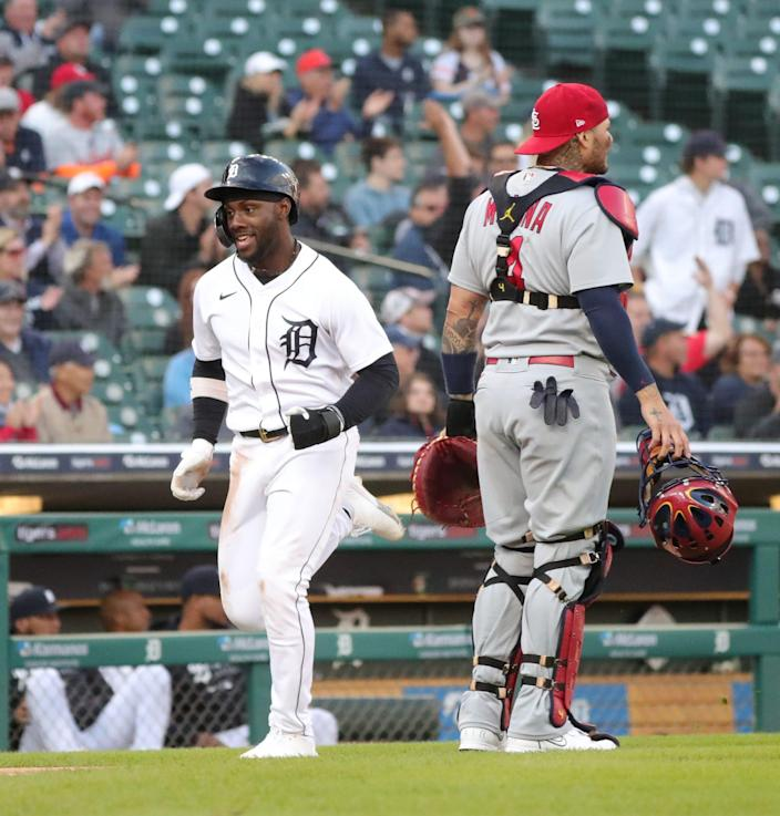 Detroit Tigers center fielder Akil Baddoo (60) scores against the St. Louis Cardinals during fourth inning action  on Tuesday, June 22, 2021, at Comerica Park in Detroit.