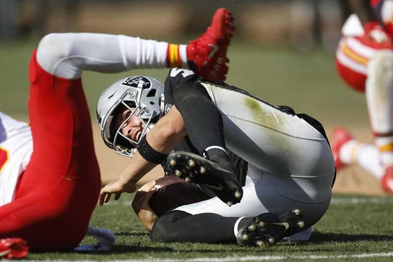 Oakland Raiders quarterback Derek Carr hits the ground after a play during the second half of an NFL football game against the Kansas City Chiefs Sunday, Sept. 15, 2019, in Oakland, Calif. Kansas City won the game 28-10. (AP Photo/D. Ross Cameron)