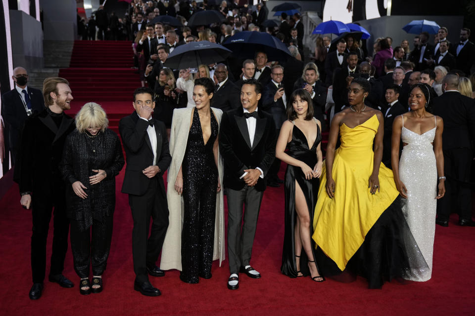 Finneas O'Connell, from left, Billie Eilish, Rami Malek, Phoebe Waller-Bridge, Cary Joji Fukunaga, Ana de Armas, Lashana Lynch and Naomie Harris pose for photographers upon arrival for the World premiere of the new film from the James Bond franchise 'No Time To Die', in London Tuesday, Sept. 28, 2021. (AP Photo/Matt Dunham)