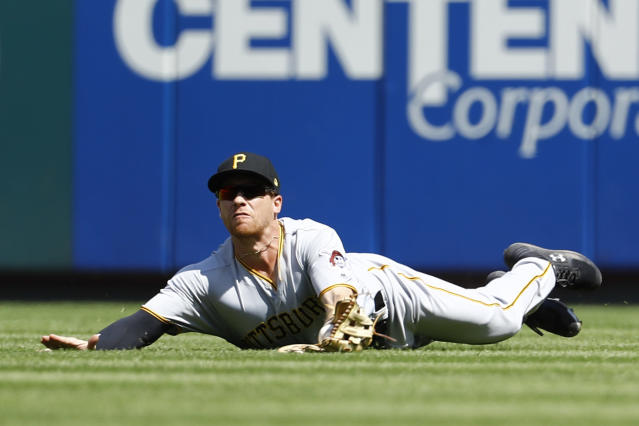 Pittsburgh Pirates right fielder Jordan Luplow makes a diving catch on a ball hit by St. Louis Cardinals' Kolten Wong during the 4th inning of a baseball game Wednesday, Sept. 12, 2018, in St. Louis. (AP Photo/Billy Hurst)