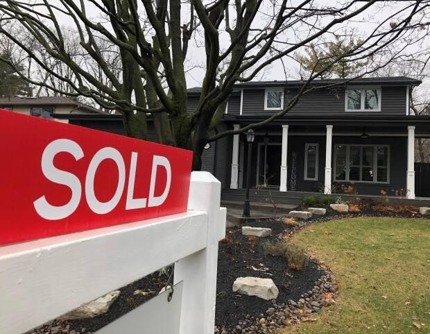 Total value of home sales topped $60 million in March. (Richard Buchan/The Canadian Press - image credit)