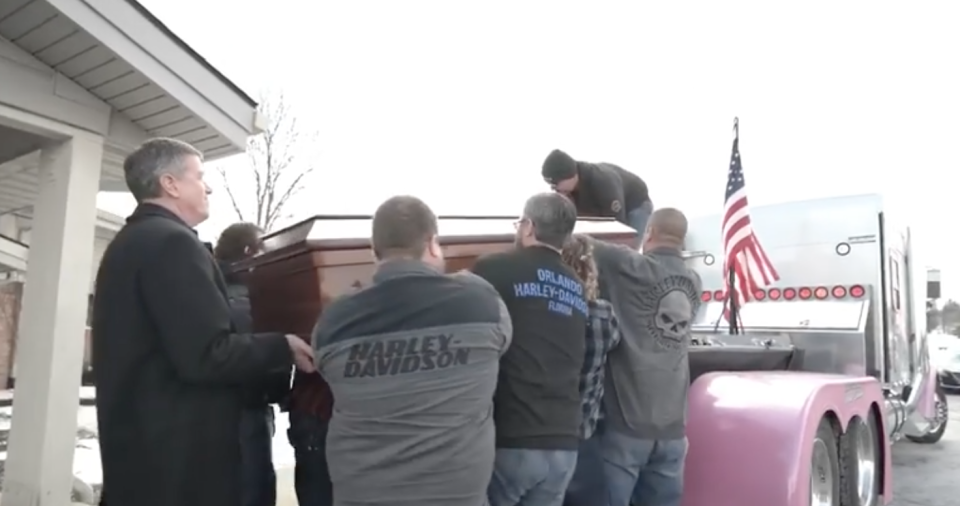 Pallbearers hoisted Shuman's casket onto the bed of one semi. (Photo: Facebook/Chris McConnell)