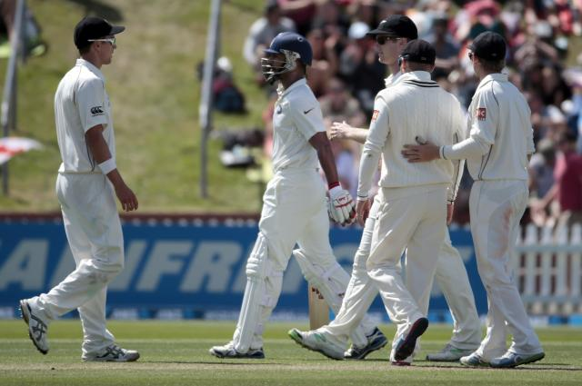 New Zealand's players celebrate the dismissal of India's Shikhar Dhawan (2nd L) for 98 during the first innings on day two of the second international test cricket match at the Basin Reserve in Wellington, February 15, 2014. REUTERS/Anthony Phelps (NEW ZEALAND - Tags: SPORT CRICKET)