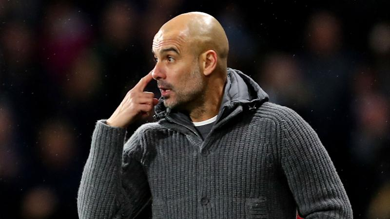 Guardiola unhappy as City keep pace with Liverpool in Huddersfield win