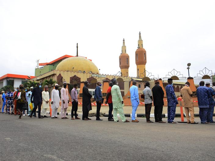 """Worshippers maintain the required social distance during the first Friday prayer outside The Lagos State Secretariat Central Mosque on August 7, 2020. <p class=""""copyright"""">Olukayode Jaiyeola/NurPhoto via Getty Images</p>"""