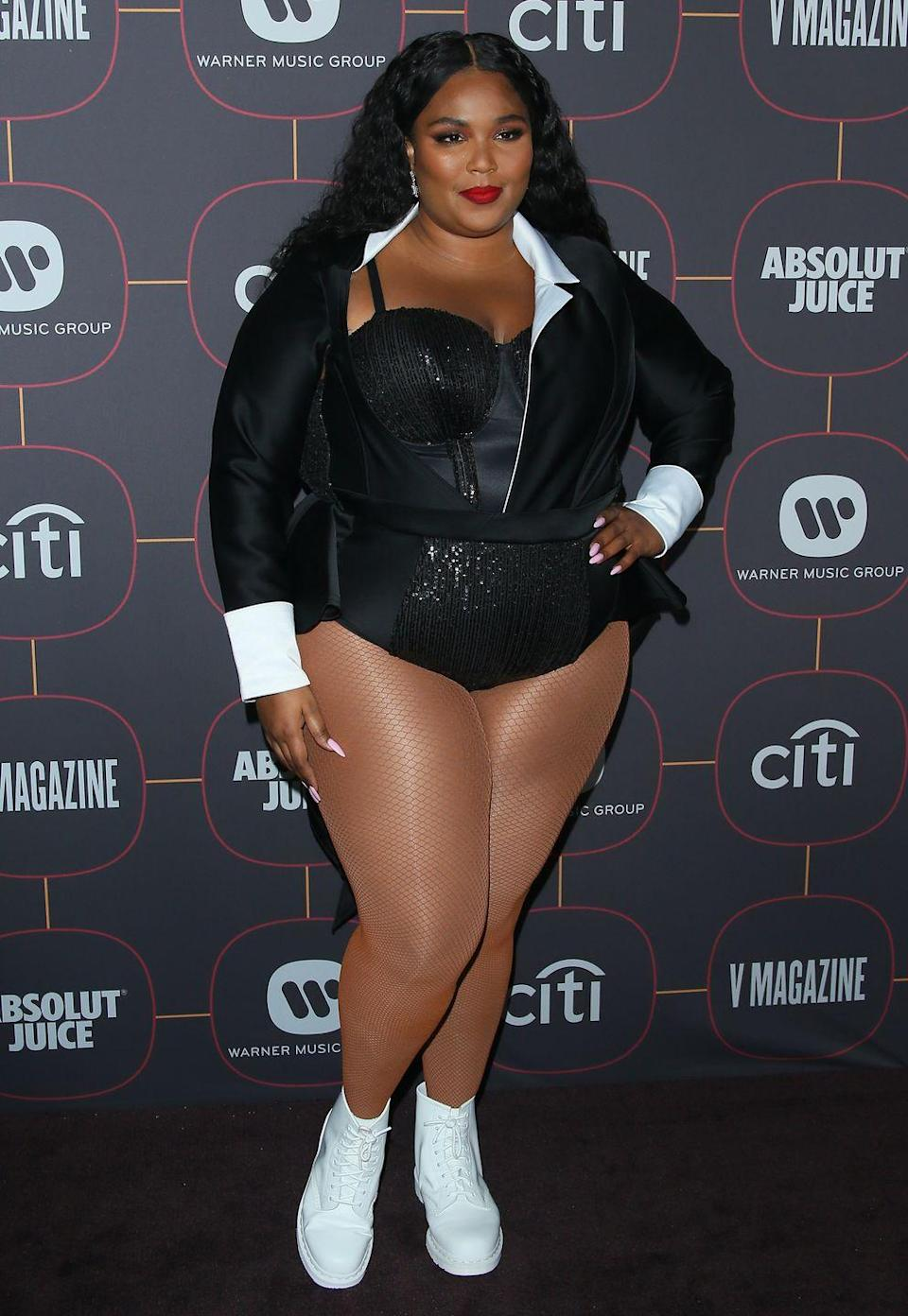<p>Attending a pre-Grammy party in a leotard and sneakers. <br></p>