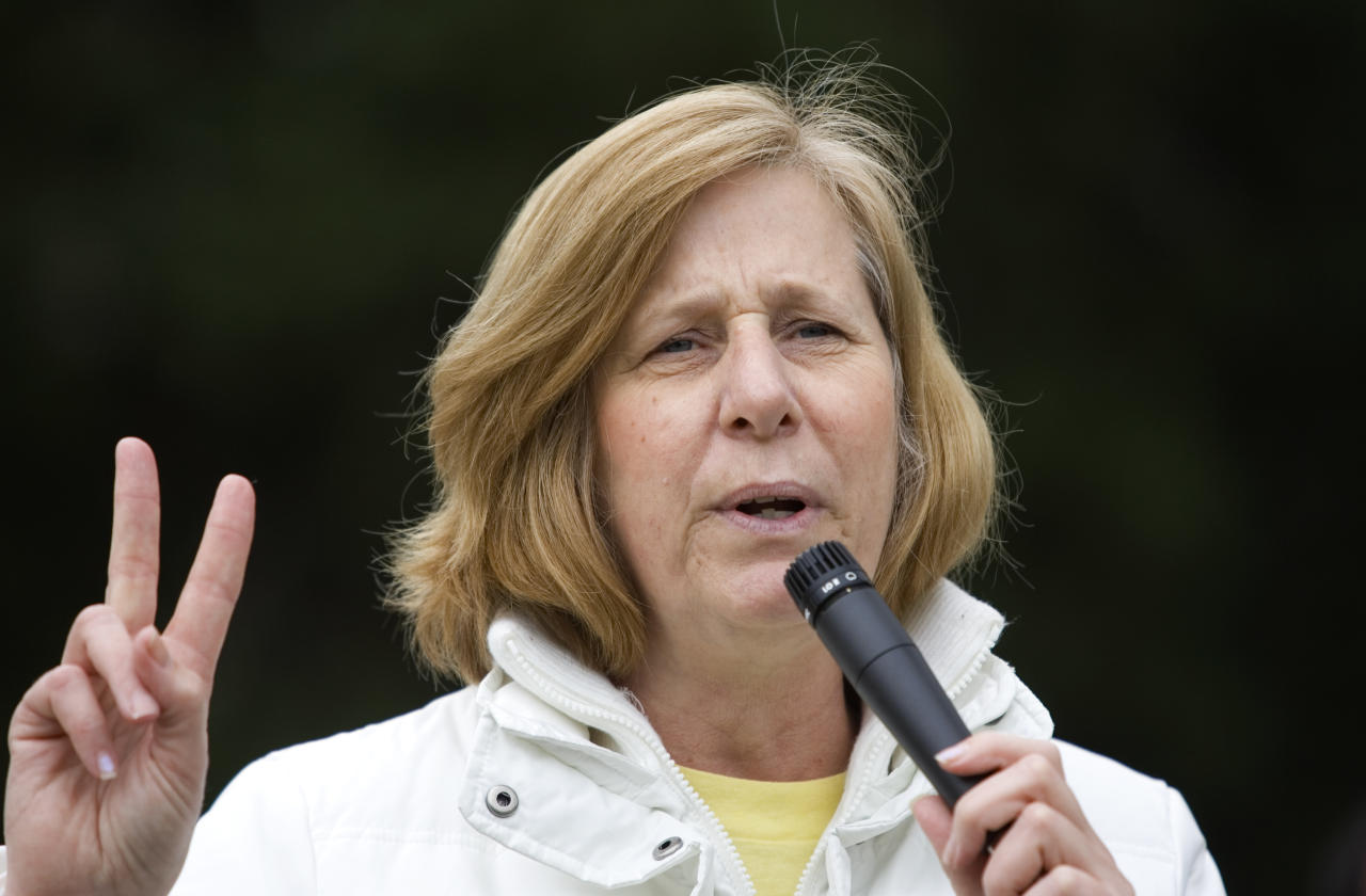 Peace activist and congressional candidate Cindy Sheehan flashes a peace sign during an anti-war protest March 19, 2008 in Berkeley, California. (Photo by Kimberly White/Getty Images)