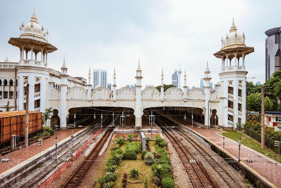 "While Kuala Lumpur Railway Station hasn't served as the <a href=""https://www.cntraveler.com/galleries/2014-11-20/art-culture-tour-kuala-lumpur-malaysia?mbid=synd_yahoo_rss"" rel=""nofollow noopener"" target=""_blank"" data-ylk=""slk:Malaysian capital's"" class=""link rapid-noclick-resp"">Malaysian capital's</a> main train station for 20 years, its Indo-Saracenic architecture continues to be a draw. Only Komuter trains stop here, but visitors can still admire the white facade, decorative arches, and chhatris, or dome-covered pavilions. Look across the street too, at the similarly designed train service administration building, which was completed in 1917—a few years after the train station first became operational."