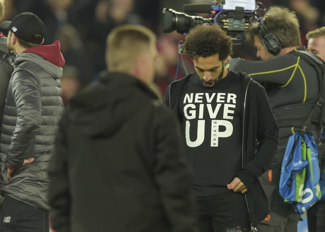 Mohamed Salah - who missed the second leg injured - wears a 'never give up' shirt