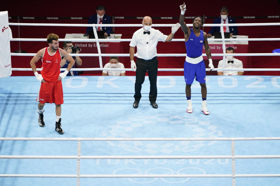 France's Sofiane Oumiha, left, reacts after losing a men's lightweight 63-kg boxing match to Keyshawn Davis of the United States, at the 2020 Summer Olympics, Saturday, July 31, 2021, in Tokyo, Japan. (AP Photo/Frank Franklin II)