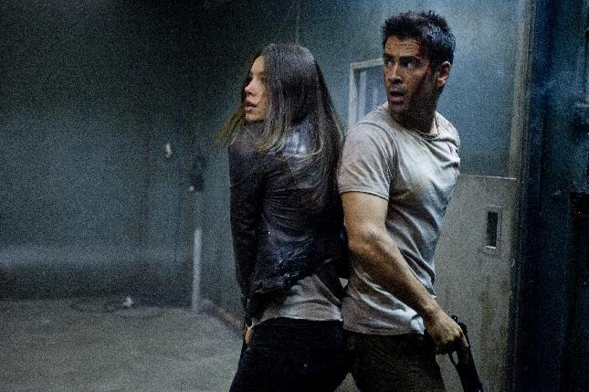 """This film image released by Columbia Pictures shows Jessica Biel , left, and Colin Farrell in a scene from the action thriller """"Total Recall."""" (AP Photo/Columbia Pictures - Sony, Michael Gibson)"""