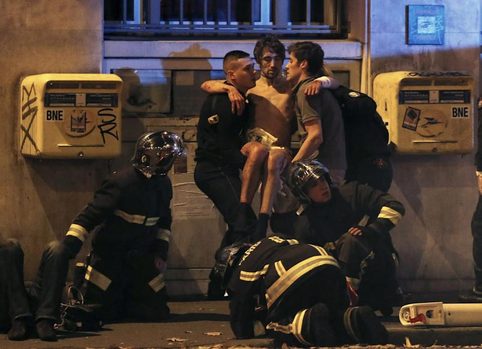 "<div class=""inline-image__caption""><p>French fire brigade members aid an injured individual near the Bataclan concert hall following fatal shootings in Paris, France, November 13, 2015.</p></div> <div class=""inline-image__credit"">Christian Hartmann/Reuters</div>"