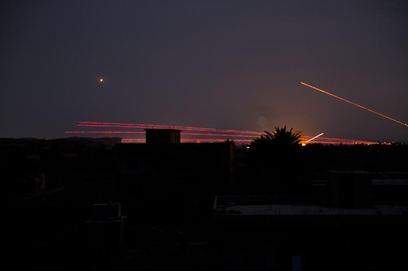 Tracer fire lights up the night sky as U.S.-backed Syrian Democratic Forces (SDF) fire on Baghouz, Syria, Sunday, March 10, 2019. U.S.-backed Syrian fighters resumed their offensive on the last pocket held by the Islamic State group in eastern Syria on Sunday lighting the skies over the besieged village as artillery shelling and heavy gunfire rang in the distance. (AP Photo/Maya Alleruzzo)