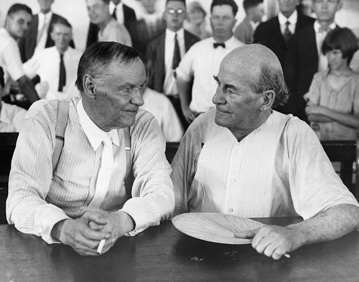 Clarence Darrow, a famous Chicago lawyer, and William Jennings Bryan, defender of Fundamentalism, have a chat in a courtroom during the Scopes evolution trial in 1925.